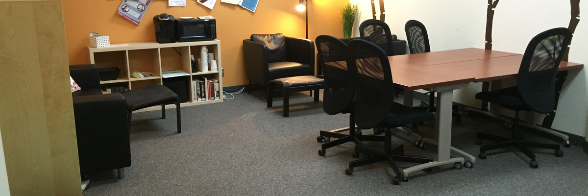 Women's Center study lounge with a table with chairs, couch.